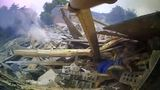 Caught on camera: Officers rush to rescue victims after house explosion