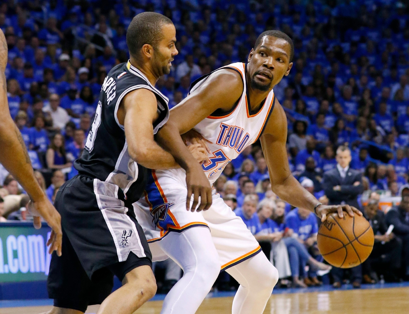 Oklahoma City Thunder forward Kevin Durant, right, drives around San Antonio Spurs guard Tony Parker, left, in the first quarter of Game 6 of a second-round NBA basketball playoff series in Oklahoma City, Thursday, May 12, 2016. (AP Photo/Alonzo Adams)