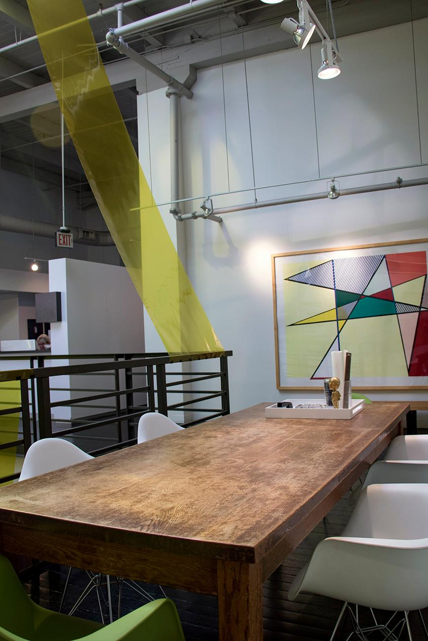 One of FRCH's open meeting areas{ }under the 7th{ }floor skylight{ }where{ }employees{ }can{ }relax, brainstorm, or host meetings. / Image: Allison McAdams // Published: 9.25.18