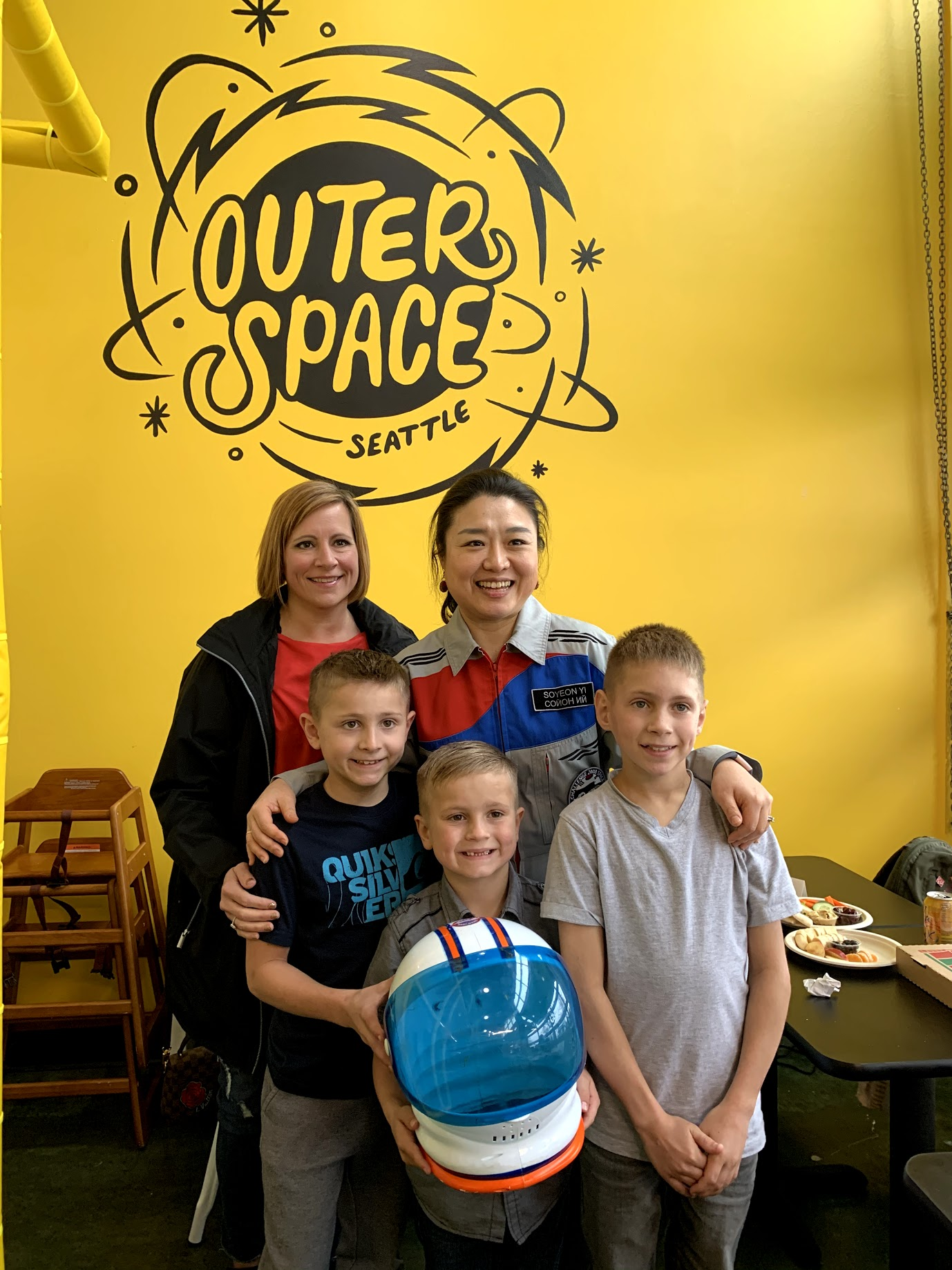 "Dr. Soyeon Yi, the first&nbsp;South Korean astronaut and 49th woman in space, stopped by to visit Outer Space Seattle this week, much to the kids joy! Outer Space Seattle is a space-themed indoor playspace for kids of all abilities that<a href=""http://seattlerefined.com/lifestyle/this-new-play-space-is-out-of-this-world"" target=""_blank"" title=""http://seattlerefined.com/lifestyle/this-new-play-space-is-out-of-this-world"">&nbsp;just opened after one passionate mom's journey from a kickstarter</a>, to a brick and mortar play area. Dr. Yi has just visited Alki Elementary when she swung by the play space, where she had&nbsp;lunch, spoke to kids about what it was like to travel through space, answered questions, talked about how important it is to exercise your body, and signed the custom built rocket. (Image: Outer Space Seattle)"