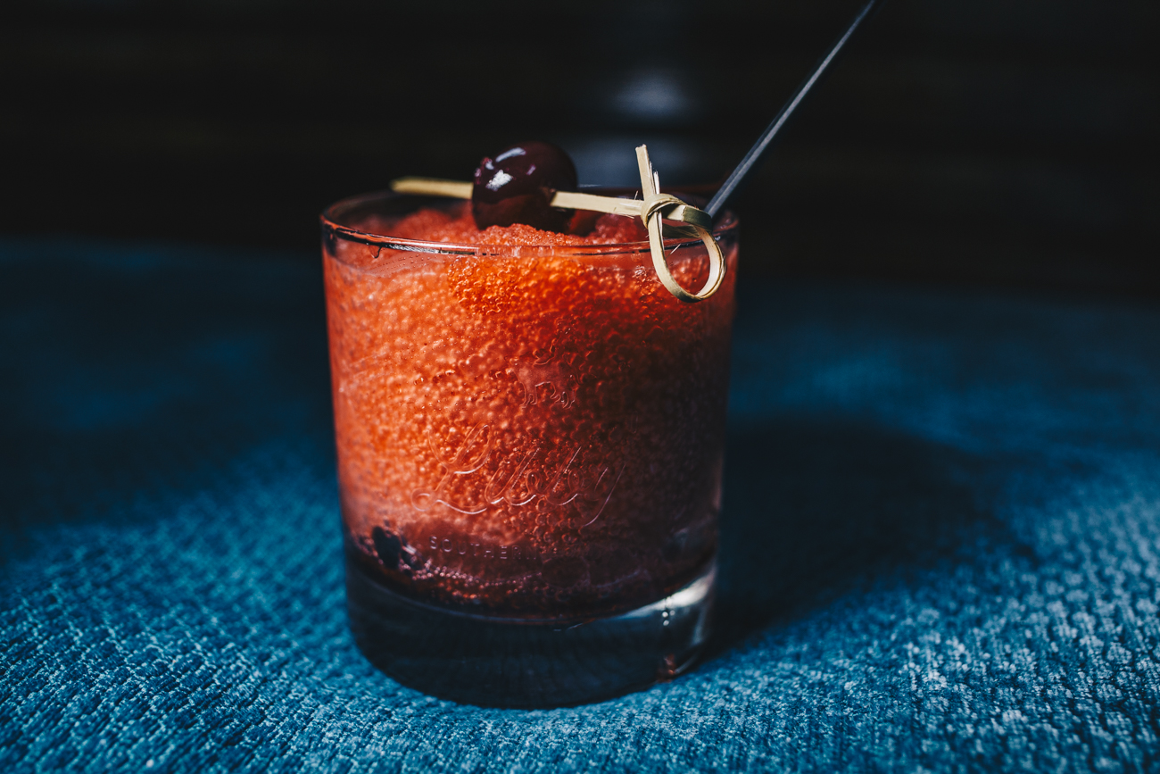 Libby's Cheerwine Bourbon Slush: Cheerwine and bourbon mixed into a slush and garnished with a Bada Bing cherry / Image: Catherine Viox // Published: 3.24.19