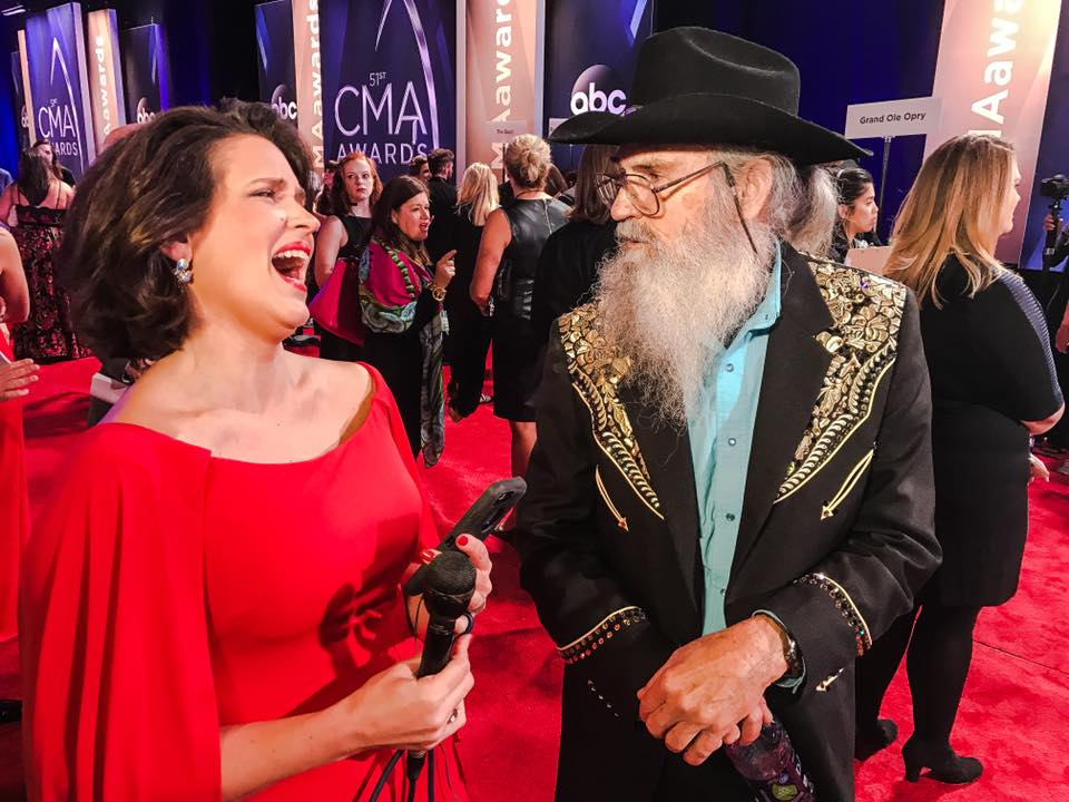 Funny guy Uncle Si from Duck Dynasty and Anchor Erika Kurre.{&amp;nbsp;} Si brought his tupperware tea cup to the Red Carpet at Bridgestone Arena. (Fox 17 News)<p></p>