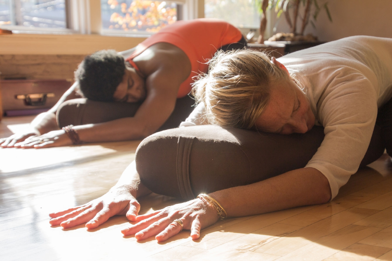 When starting out, consider taking a few different classes at different studios to find the one that best fits you and your needs. Before you head to the yoga studio though, find out if yoga mats and props are provided or if you need to bring your own. Also wear clothing that is comfortable to move in. (Image: 8 Limbs Yoga)