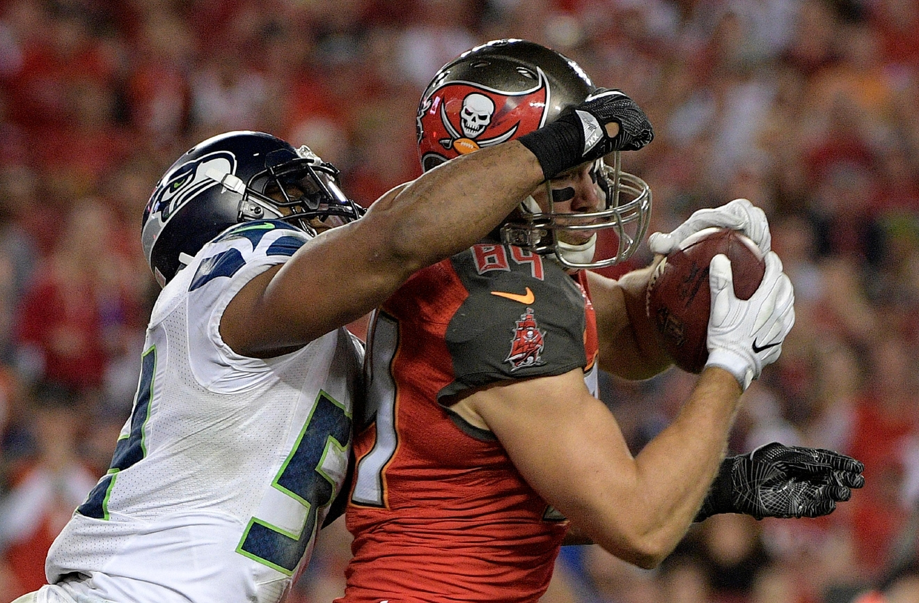 Seattle Seahawks middle linebacker Bobby Wagner (54) hits Tampa Bay Buccaneers tight end Cameron Brate (84) after a reception during the fourth quarter of an NFL football game Sunday, Nov. 27, 2016, in Tampa, Fla. (AP Photo/Phelan Ebenhack)