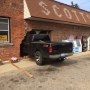 Woman walks away with no injuries after truck crashes through store in Scotts