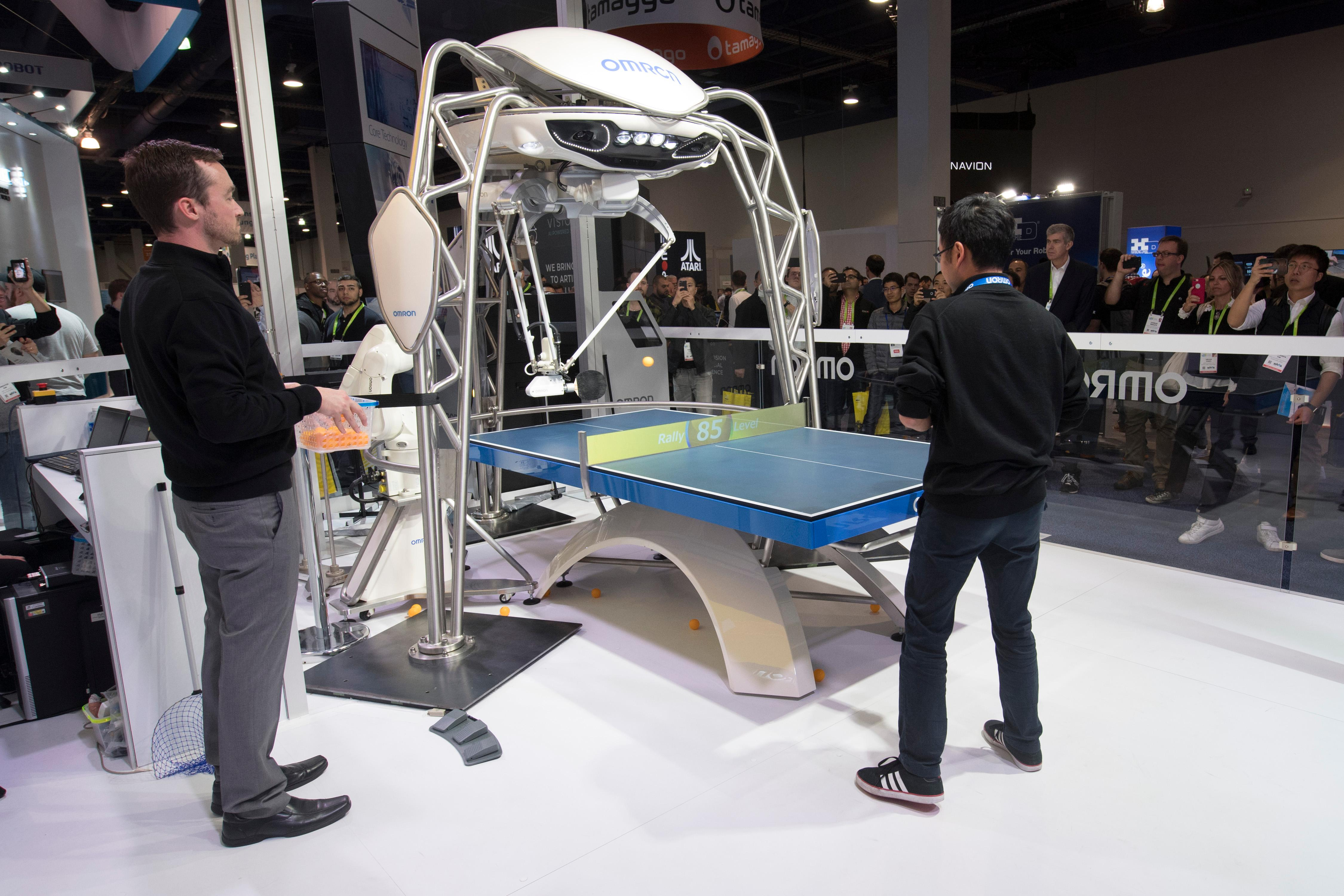A man plays table tennis against a robot from Omron during the second day of CES Wednesday, January 10, 2018, at the Las Vegas Convention Center. CREDIT: Sam Morris/Las Vegas News Bureau
