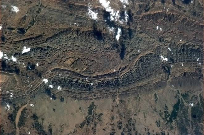 Tortured rock where India crashed into Asia and pushed up the Himalayas (Photo & Caption: Col. Chris Hadfield, NASA)