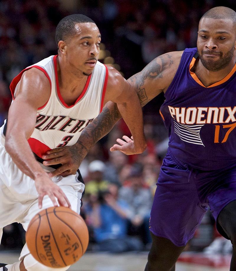 Portland Trail Blazers guard C.J. McCollum, left, dribbles past Phoenix Suns forward P.J. Tucker during the first half of an NBA basketball game in Portland, Ore., Tuesday, Nov. 8, 2016. (AP Photo/Craig Mitchelldyer)