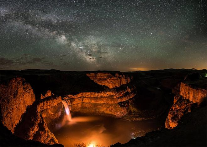 Palouse Falls, in SE Washington State. A group of campers were at the base of the falls with a large bonfire, and it lit up the canyon nicely to match the milky way overhead. This is a panorama put together from 6 separate time-exposure photos to capture the full scene. Photo: Scott Butner