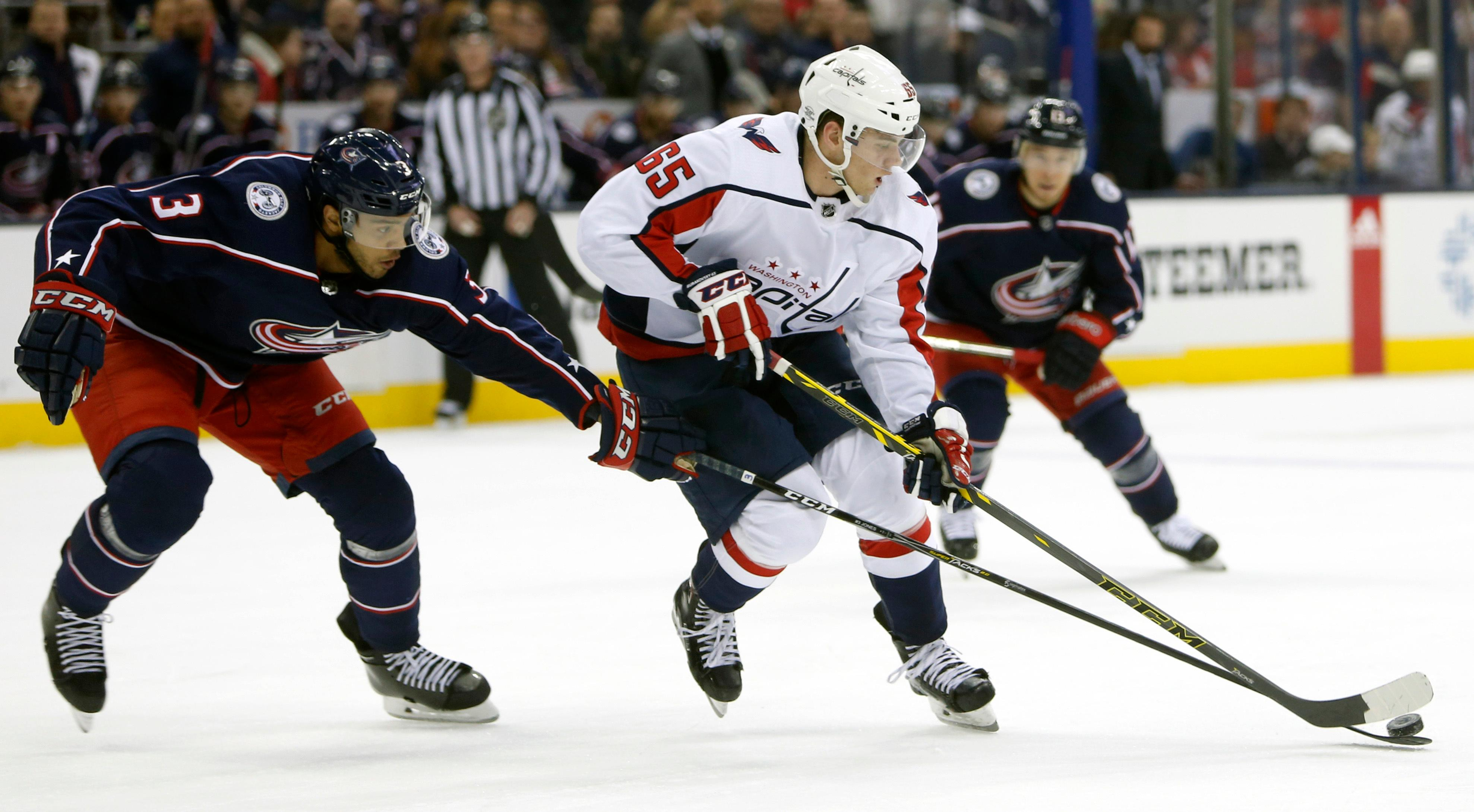 Washington Capitals' Andre Burakovsky, right, of Austria, looks for an open shot as Columbus Blue Jackets' Seth Jones defends during the first period of an NHL hockey game Tuesday, Feb. 6, 2018, in Columbus, Ohio. (AP Photo/Jay LaPrete)