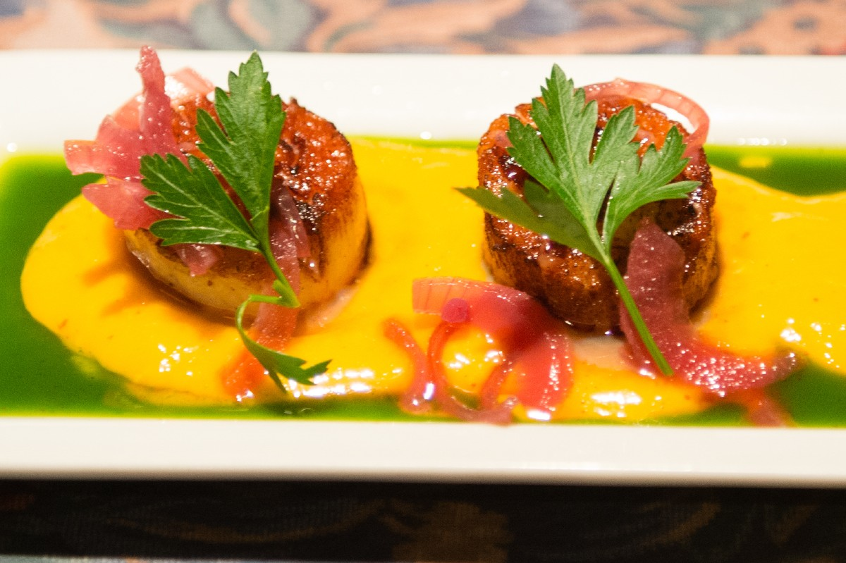 The Depot's Peruvian Mango Sea Scallops are a feast for both the eyes and your mouth. Served atop vibrant mango salsa, you'd be remiss not to order this small plate. (Image: Chona Kasinger / Seattle Refined)