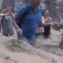 Hikers form human chain to help each other cross flash flood