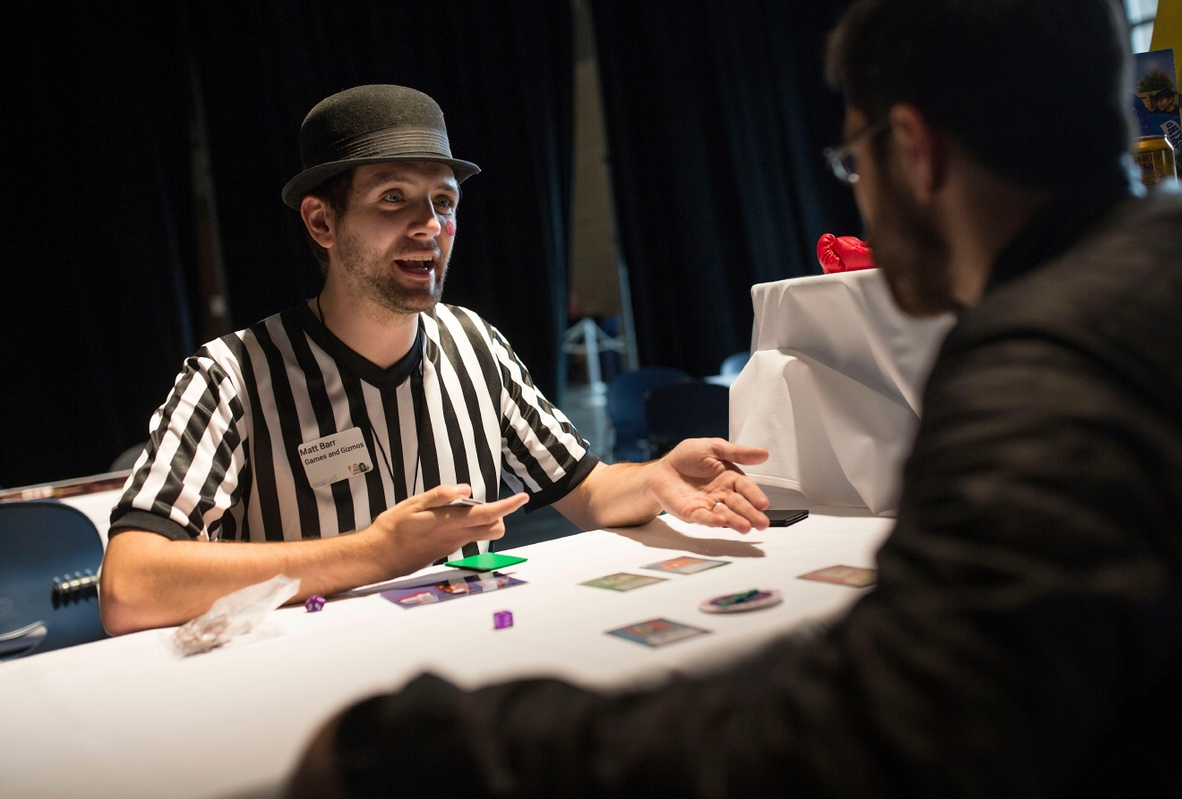 Matt Bar, creator of Beatdown: Streets of Justice, explains his card game that he developed at the 6th annual Geekwire Bash at the CenturyLink Event Center. (Sy Bean / Seattle Refined)