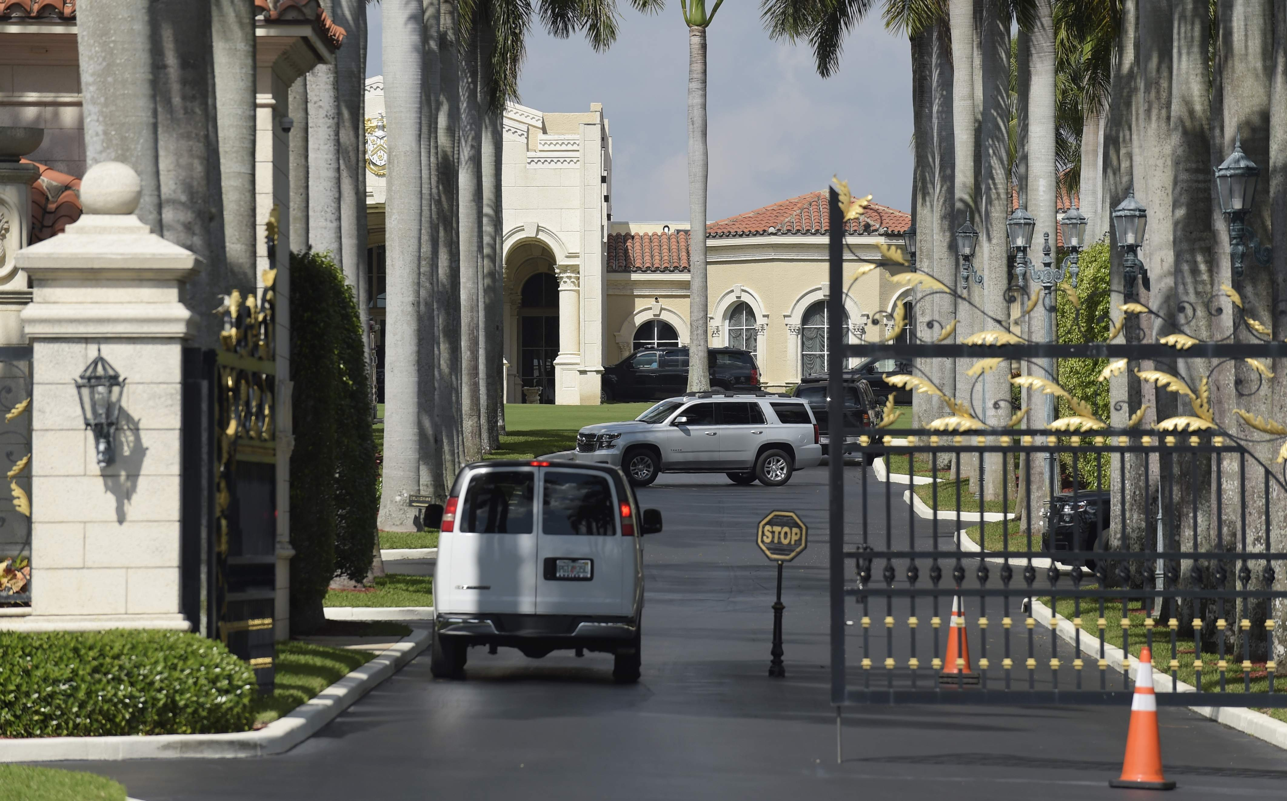 DAY 31 - in this Feb. 19, 2017, file photo, a vehicle stops at the gate of the Trump International Golf Club in West Palm Beach, Fla., while President Donald Trump is at the club. The president was in Mar-a-Lago for the weekend and had no public events on his schedule and was not photographed on day 31. (AP Photo/Susan Walsh, file)