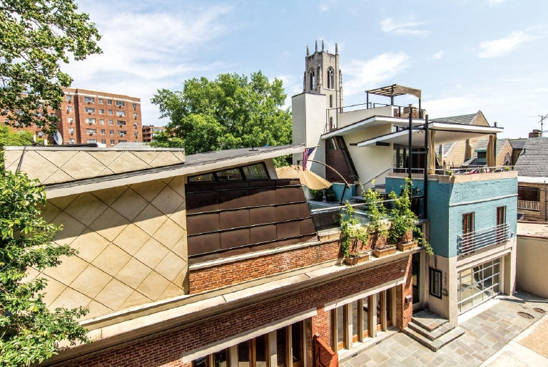 This five-bedroom, five-bath, 5,222-square-foot Kalorama house is on the market for $4.5 million. The former Airbnb property comes with some pretty awesome amenities such as a heated rooftop pool with an underwater window into the living room, two koi ponds, an 18-foot entry foyer,  a 25-foot stone waterfall and a game room complete with a London-style phone booth. (Image: Courtesy Compass Realty)
