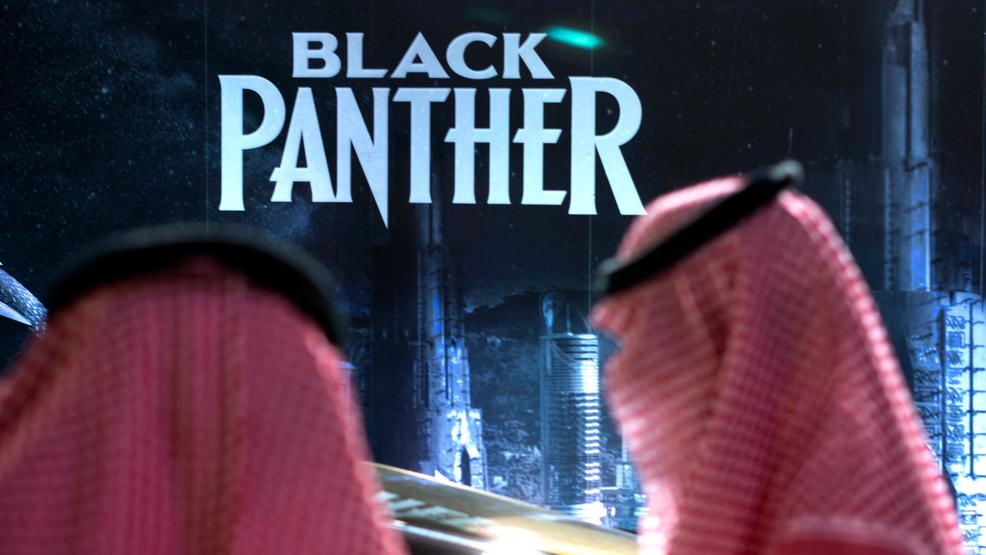 First saudi cinema opens with popcorn and black panther wsyx visitors wait in front of a black panther movie banner during an invitation only screening at the king abdullah financial district theater in riyadh stopboris Gallery
