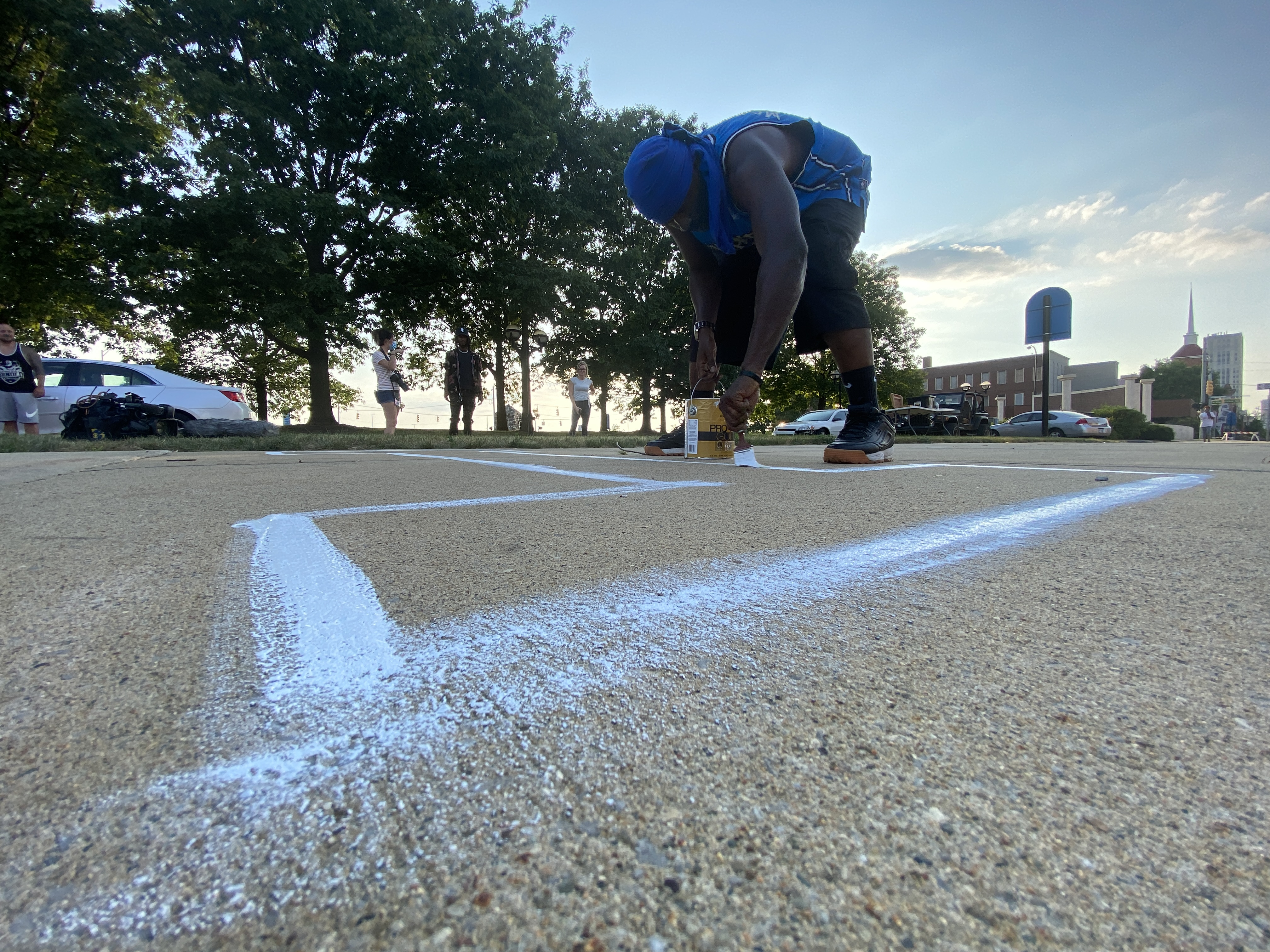 The sidewalk was closed off for the evening of Tuesday, July 7, 2020, and will be until the mural is finished. (WWMT/Jason Heeres)