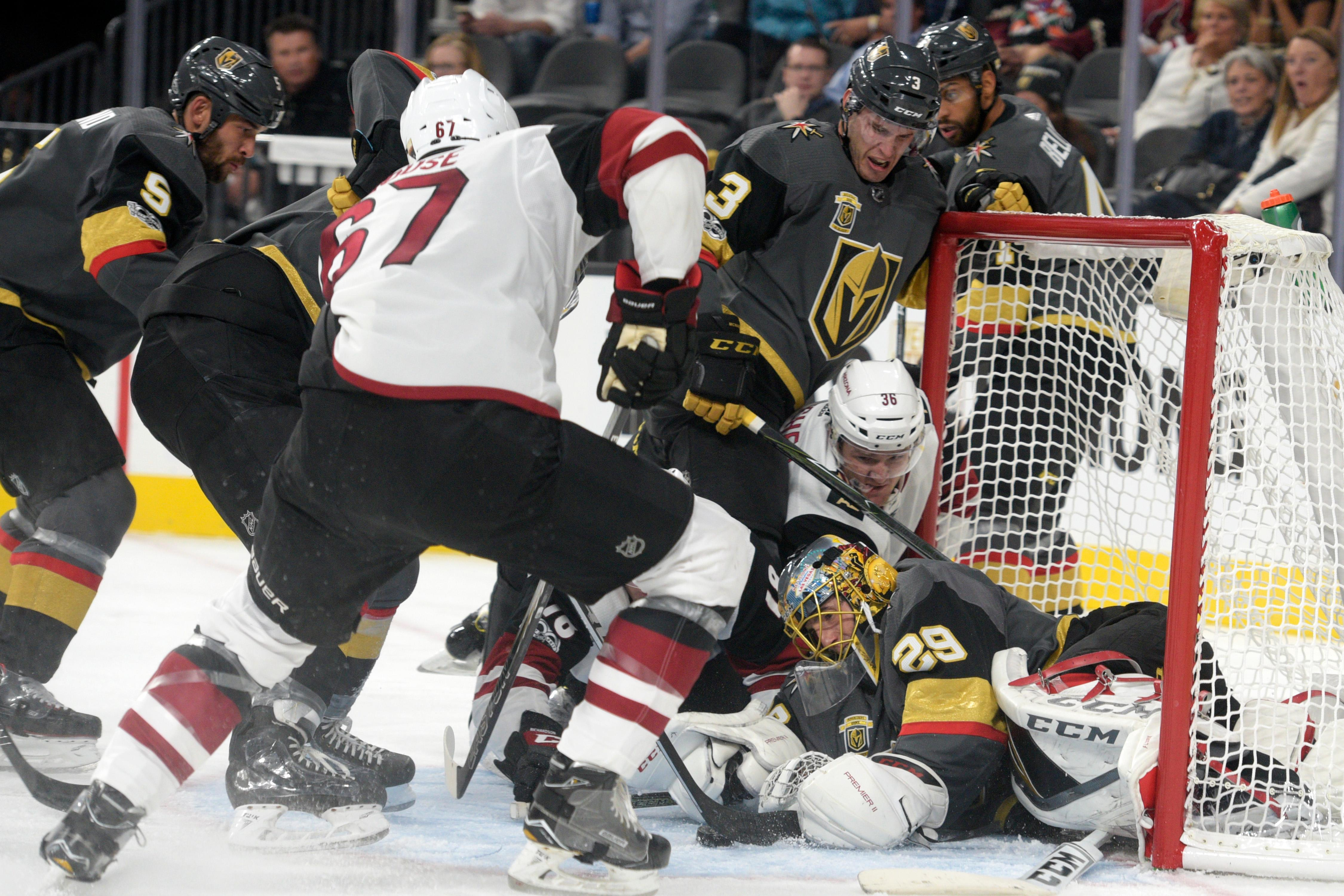 Vegas Golden Knights goalie Marc-Andre Fleury (29) gets shoved into his net while making a save against the Arizona Coyotes during the Knights home opener Tuesday, Oct. 10, 2017, at the T-Mobile Arena. The Knights won 5-2 to extend their winning streak to 3-0. CREDIT: Sam Morris/Las Vegas News Bureau