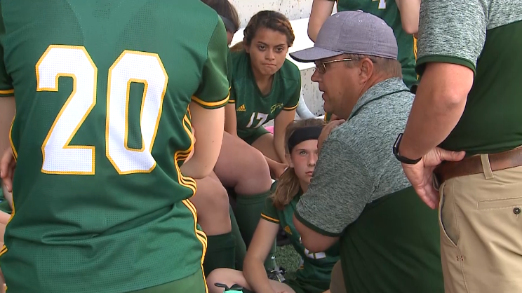 Kearney Catholic head coach Bruce Lear talks to his team during half time of the Class B quarterfinal, May 12, 2017, versus Columbus Scotus (NTV News)