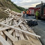 Overturned truck on Hwy 299 spills lumber, traps driver