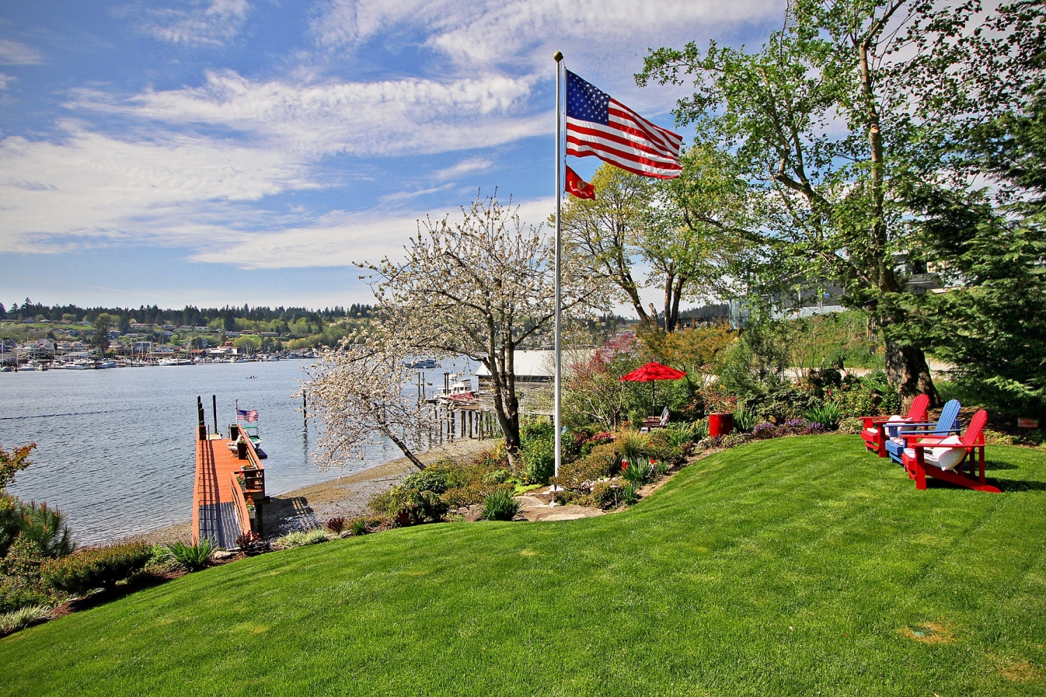 "<p>This beautiful and custom waterfront home holds a new record for Gig Harbor - the highest selling home at $3.5M! Listed by Michael Morrison of Sotheby's this home is *unfortunately* not on the market anymore, but Morrison was kind enough to give us a sneak peek. The beauty home sits on the shores of Gig Harbor Bay with a 200' pier with deep water dock, an open floor plan with soaring 17' ceilings, chef's kitchen with Carrera marble counter and butler's pantry, stainless steel appliances, luxurious en-suite with soaking tub and oversized shower, master suite with fireplace and walk in closet, Nano inspired doors, detached three car garage with potting area, soothing waterfall, multi-use Sail loft-game room-shop, built in vacuum, Quartersawn Oak floors, radiant in floor heating, remote control blinds, Ironwood Deck with Awning and Sun Screen, and SO MUCH MORE. Even though the house is sold, take a peek through our gallery and learn more at{&nbsp;}<a  href=""http://www.goodmandrive.com/"" target=""_blank"" title=""http://www.goodmandrive.com/"">Sotheby's blogpost</a>.{&nbsp;} (Image courtesy of Michael Morrison of Sotheby's).</p>"