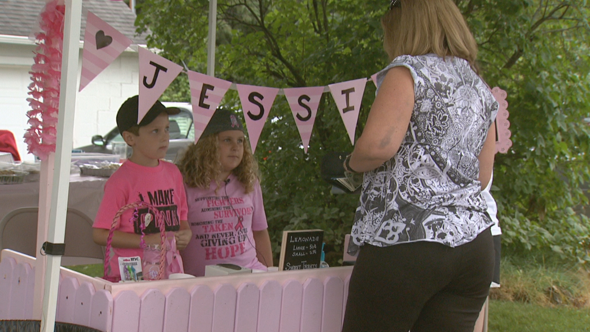Two Marinette children are raising money for the Bellin Health Cancer team in honor of their mother Jessica, who lost her battle with breast cancer, August 11, 2017. (WLUK)