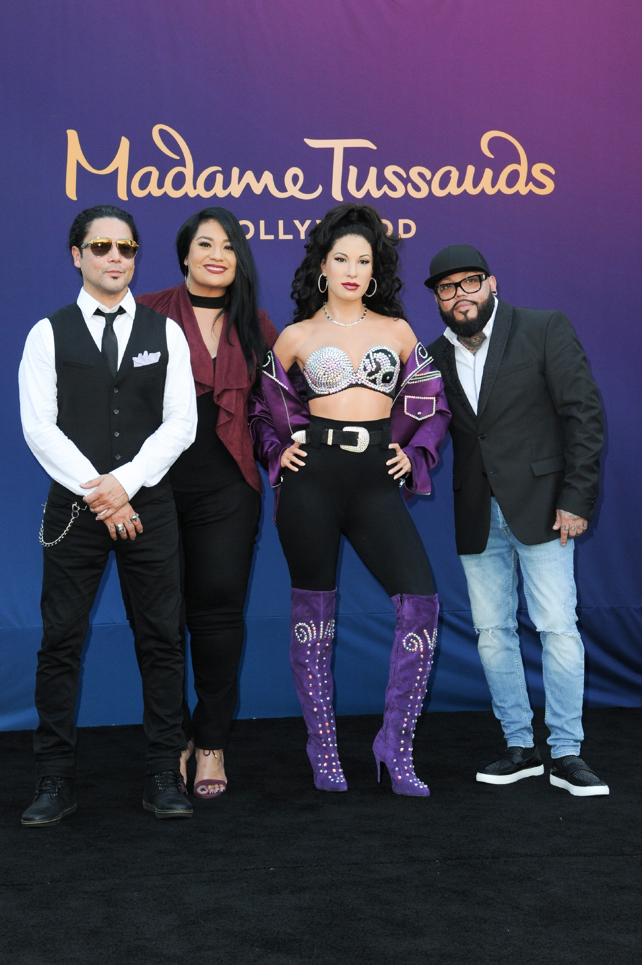 Chris Perez, from left, Suzette Quintanilla and A.B. Quintanilla attend the unveiling of a wax figure of Selena Quintanilla at Madame Tussauds Hollywood on Tuesday, Aug. 30, 2016, in Los Angeles. (Photo by Richard Shotwell/Invision/AP)