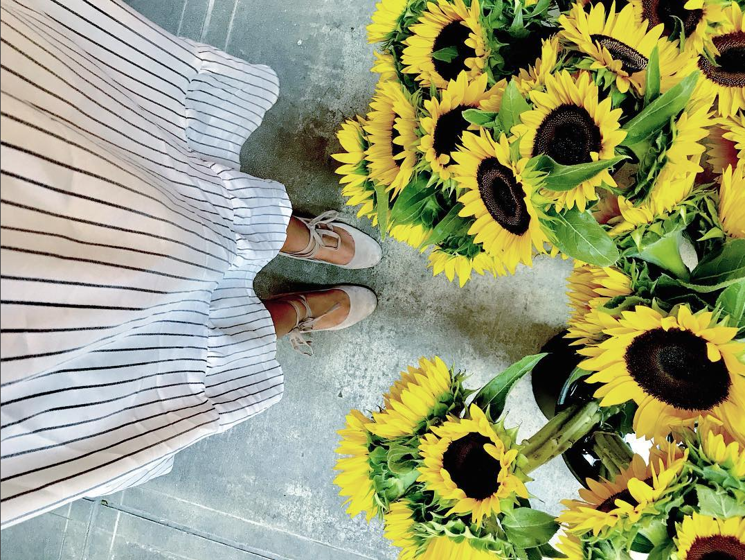 This look is so feminine - and it's not just the sunflowers from Eastern Market. (Image via @sierralangford)