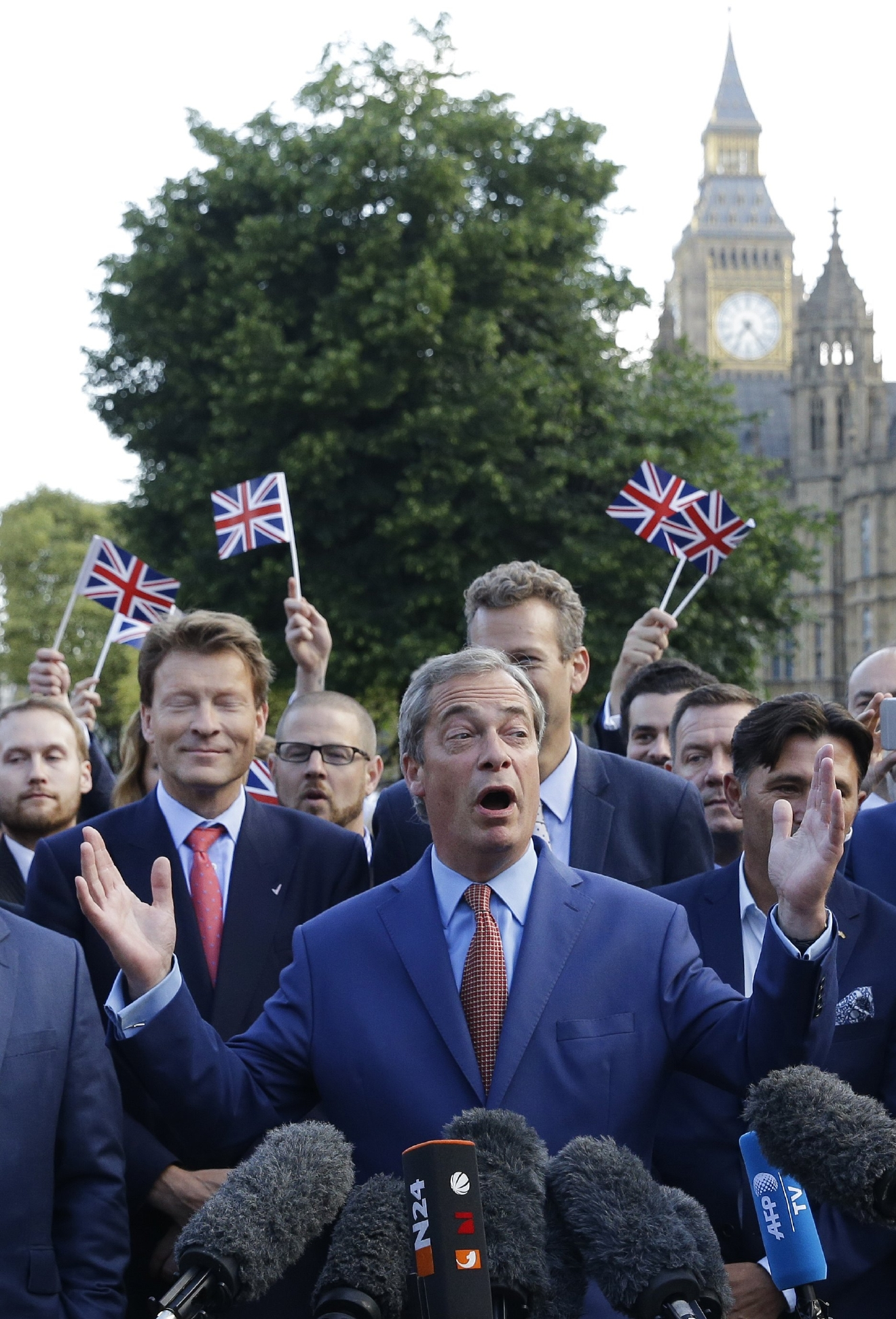 Nigel Farage, the leader of the UK Independence Party speaks to the media on College Green in London, Friday, June 24, 2016. Britain voted to leave the European Union after a bitterly divisive referendum campaign, according to tallies of official results Friday. (AP Photo/Matt Dunham)