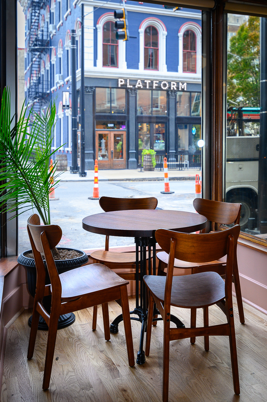 Seating was added in the front windows so patrons can enjoy the Japp's unique view up and down 12th and Main Streets while drinking cocktails. / Image: Phil Armstrong, Cincinnati Refined // Published: 10.25.19