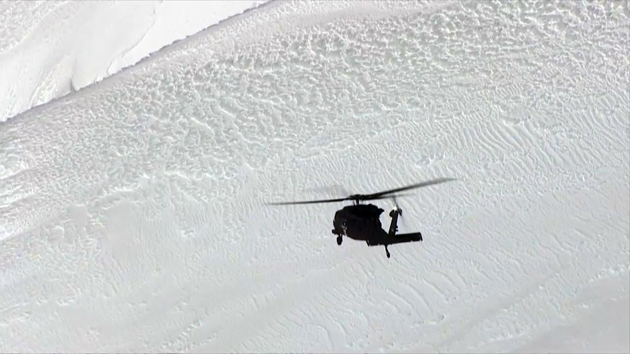 An Oregon Army National Guard Blackhawk helicopter flies over Mount Hood on Tuesday, Feb. 13, 2018 during a mission to rescue a climber who fell. The climber was later pronounced dead. (KATU Photo/Chopper 2)