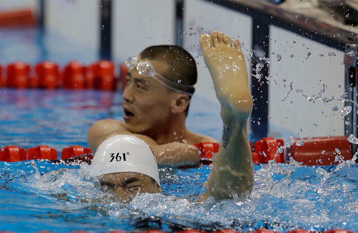 Zheng Tao of China celebrates his victory in the men's 100-meter backstroke S6 swimming event at the Paralympic Games in Rio de Janeiro, Brazil, Thursday Sept. 8, 2016. (AP Photo/Leo Correa)