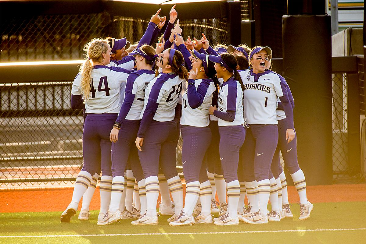 The Washington Huskies get pumped before the game. In Game Two of a three-game series, the University of Oregon Ducks softball team defeated the University of Washington Huskies 4-1 Friday night in Jane Sanders Stadium. Danica Mercado (#2), Alexis Mack (#10) and Mia Camuso (#7) all scored in the win, Mack twice. The Ducks play the Huskies for the tie breaker on Saturday with the first pitch at noon. Photo by August Frank, Oregon News Lab