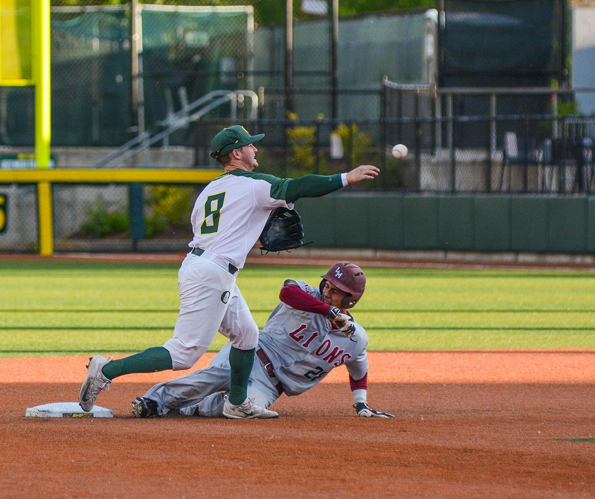 Ducks second baseman Morgan McCullough (#9) turns a double play as Lions runner Niko Decolati (#28) slides into the bag. On Wednesday night the Ducks fell to the Loyola Marymount Lions 4-0 at PK Park. Photo by Jacob Smith, Oregon News Lab