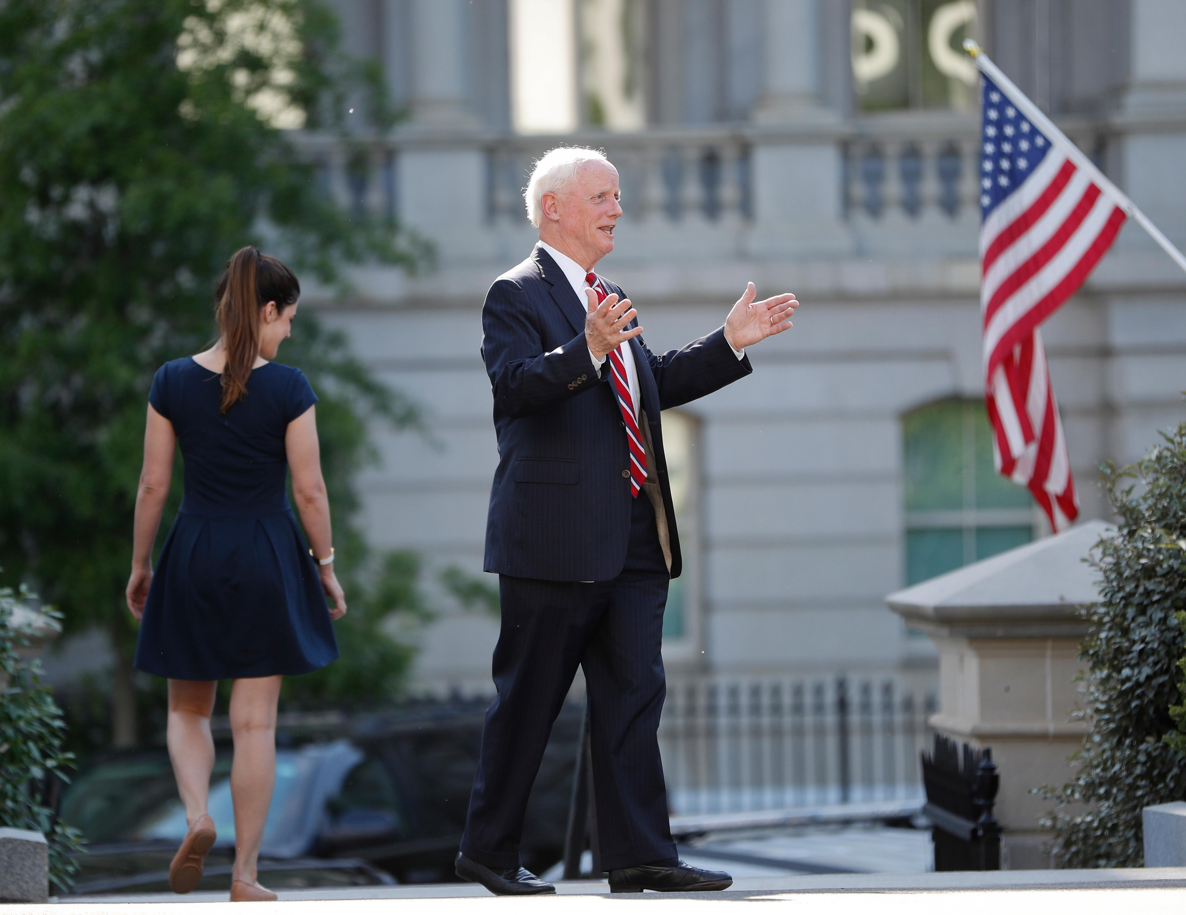 Former Oklahoma Gov. Frank Keating stops to answers questions from members of the media as he leaves the West Wing of the White House in Washington, Wednesday, May 17, 2017. The White House says President Donald Trump will be interviewing four potential candidates to lead the FBI. (AP Photo/Pablo Martinez Monsivais)