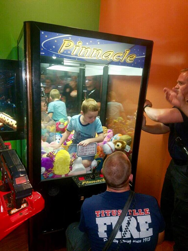 (image: Titusville Fire){ }A Toy Story: Boy rescued from the 'claw' machine