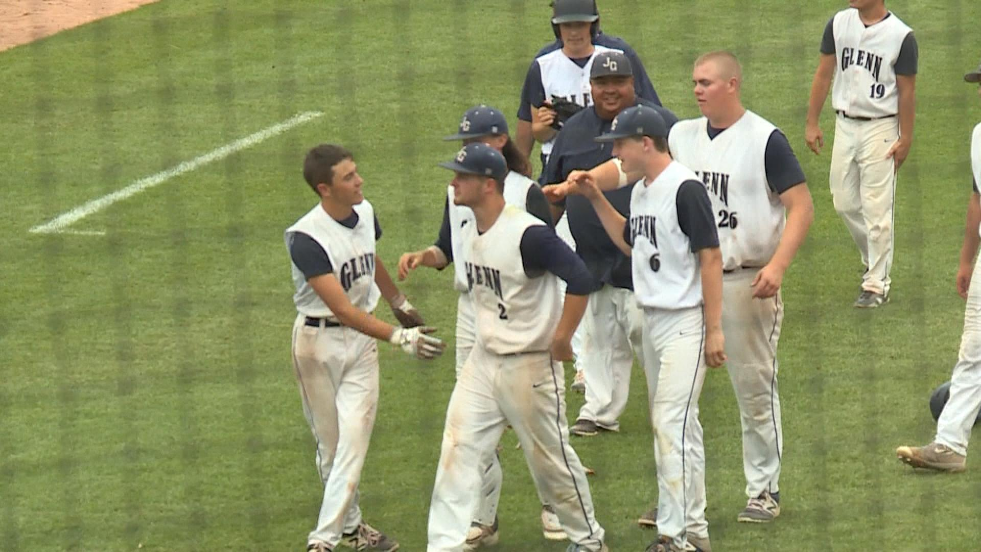The Bay City John Glenn baseball team pats each other on the back for a season well played after a loss in the state championship game.