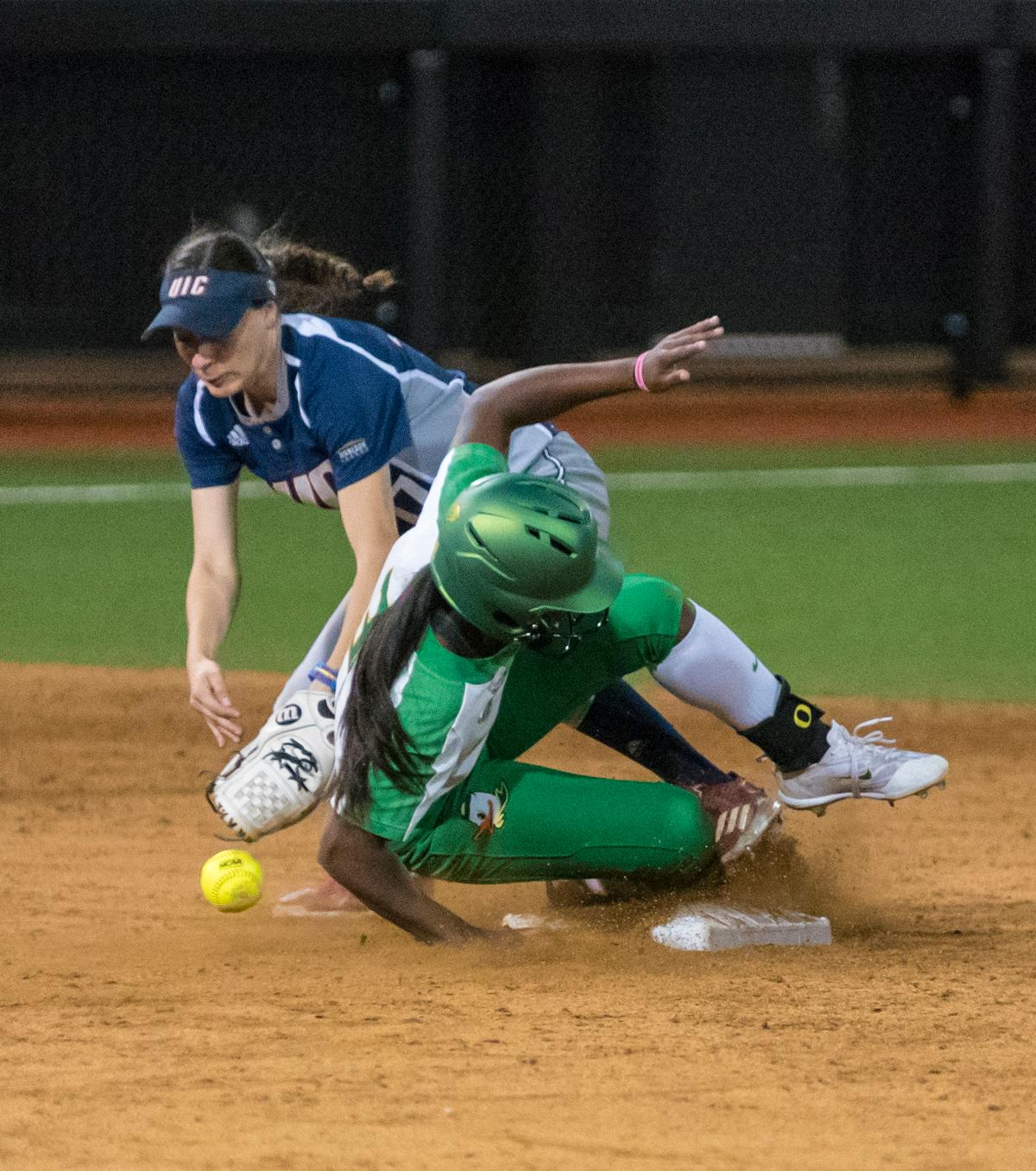 Oregon Ducks Cherish Burks (#31) safely slides into second. The No. 3 Oregon Ducks defeated the University of Illinois Chicago Flames 13-0 with the run-rule on Saturday night at Jane Sanders Stadium. The Ducks scored in every inning and then scored nine runs at the bottom of the fourth. The Oregon Ducks are now 22-0 in NCAA regional games. The Oregon Ducks play Wisconsin next on Saturday, May 20 at 2pm at Jane Sanders Stadium. Photo by Cheyenne Thorpe, Oregon News Lab