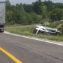 SUV sideswipes semi then overturns multiple times