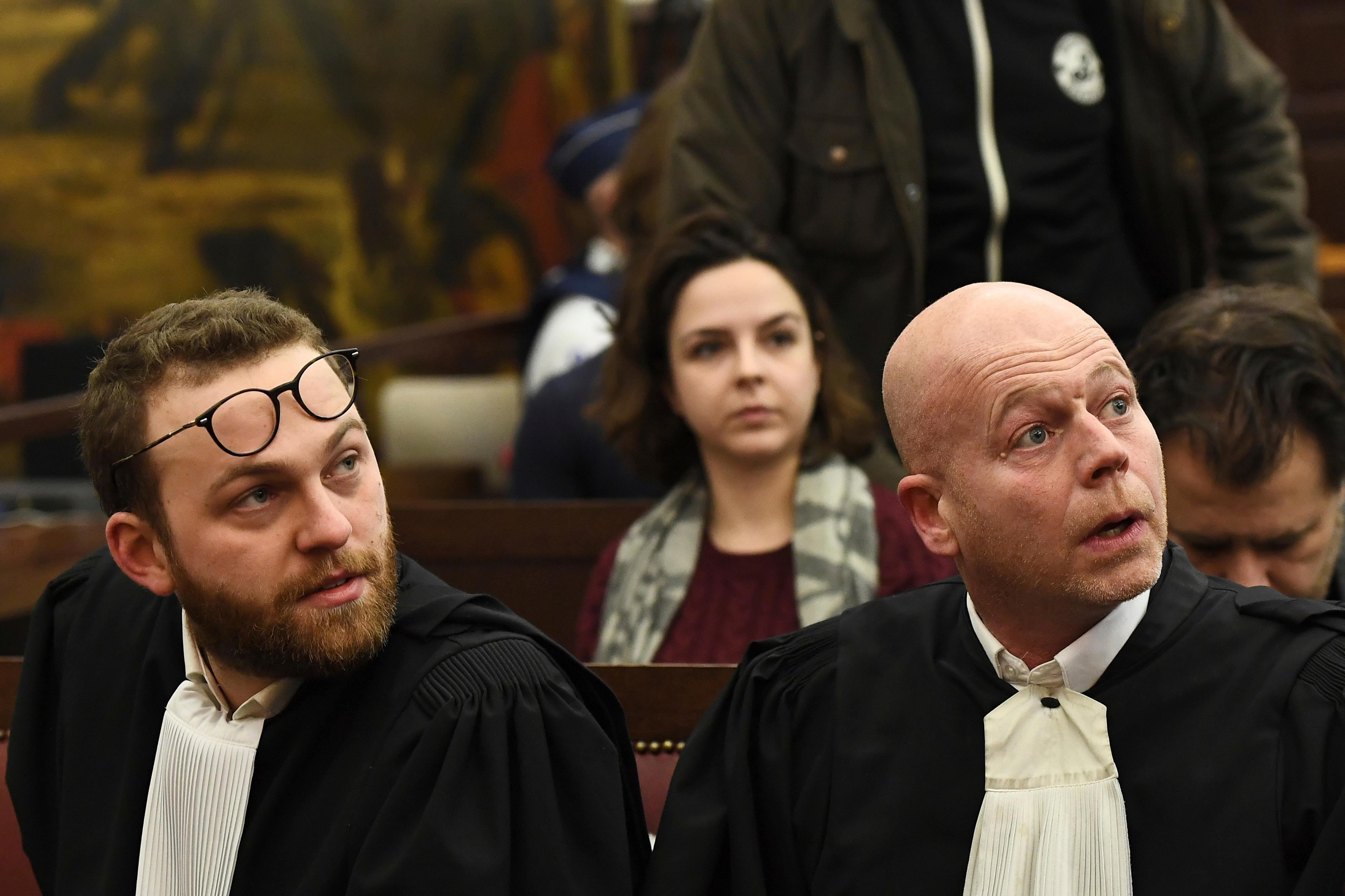 Belgian lawyer Sven Mary, right, and lawyer Romain Delcoigne, left, attend the trial of Salah Abdeslam at the Brussels Justice Palace in Brussels on Monday, Feb. 5, 2018. Salah Abdeslam and Soufiane Ayari face trial for taking part in a shooting incident in Vorst, Belgium on March 15, 2016. The incident took place when six members of a Franco-Belgian research team investigating the attacks in Paris were conducting a search in an allegedly empty safe house of the terrorists and were attacked. (Emmanuel Dunand, Pool Photo via AP)