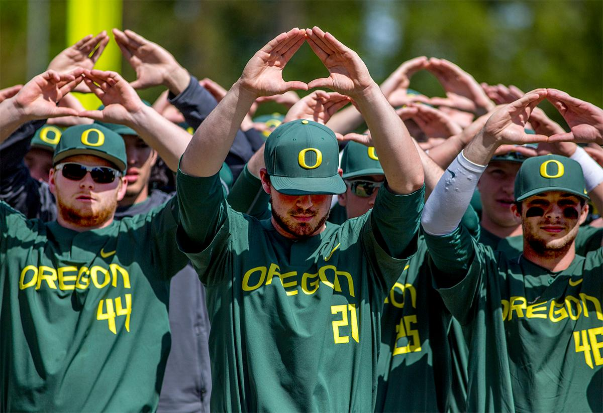"The Ducks put up ""O"" to the crowd after taking the win in the final game against Arizona. The Ducks defeated the Arizona State Sun Devils 3-2 on Sunday in the final game of the three-game series to close out the series with two wins and one loss. Jacob Bennett (#16) gave the Ducks their first point in the third inning. Kyle Kasser (#9) and Morgan McCullough (#1) added two more points in the 4th inning to give the Ducks enough of a lead to hold off the Sun Devils to the end of the ninth. Photo by August Frank, Oregon News Lab"