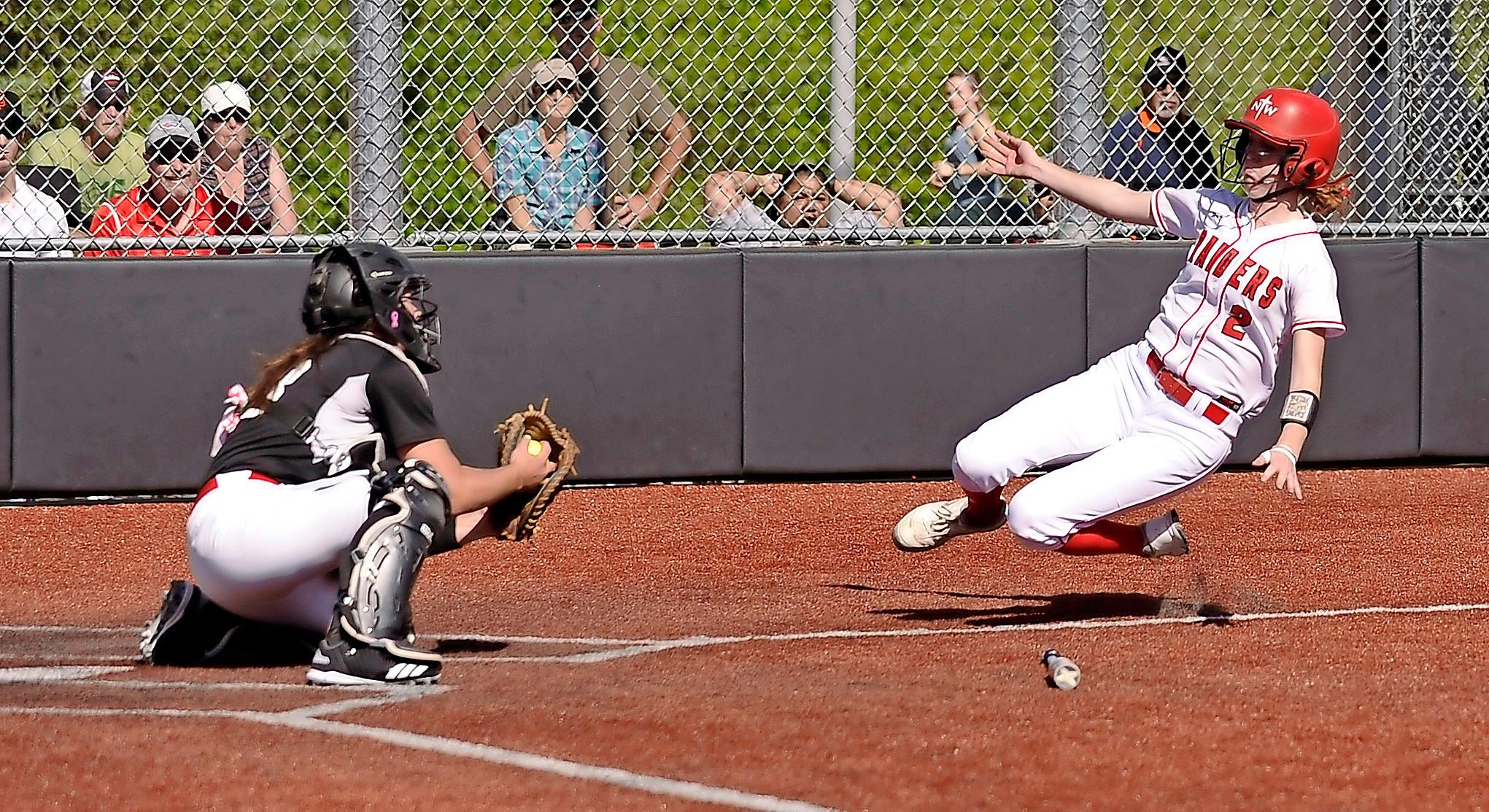 Andy Atkinso/Daily TidingsSouthern Oregon University senior catcher Harlee Donovan awaits the tag to Northwestern's Emily Bosch sliding into home plate in the top of the fourth inning.