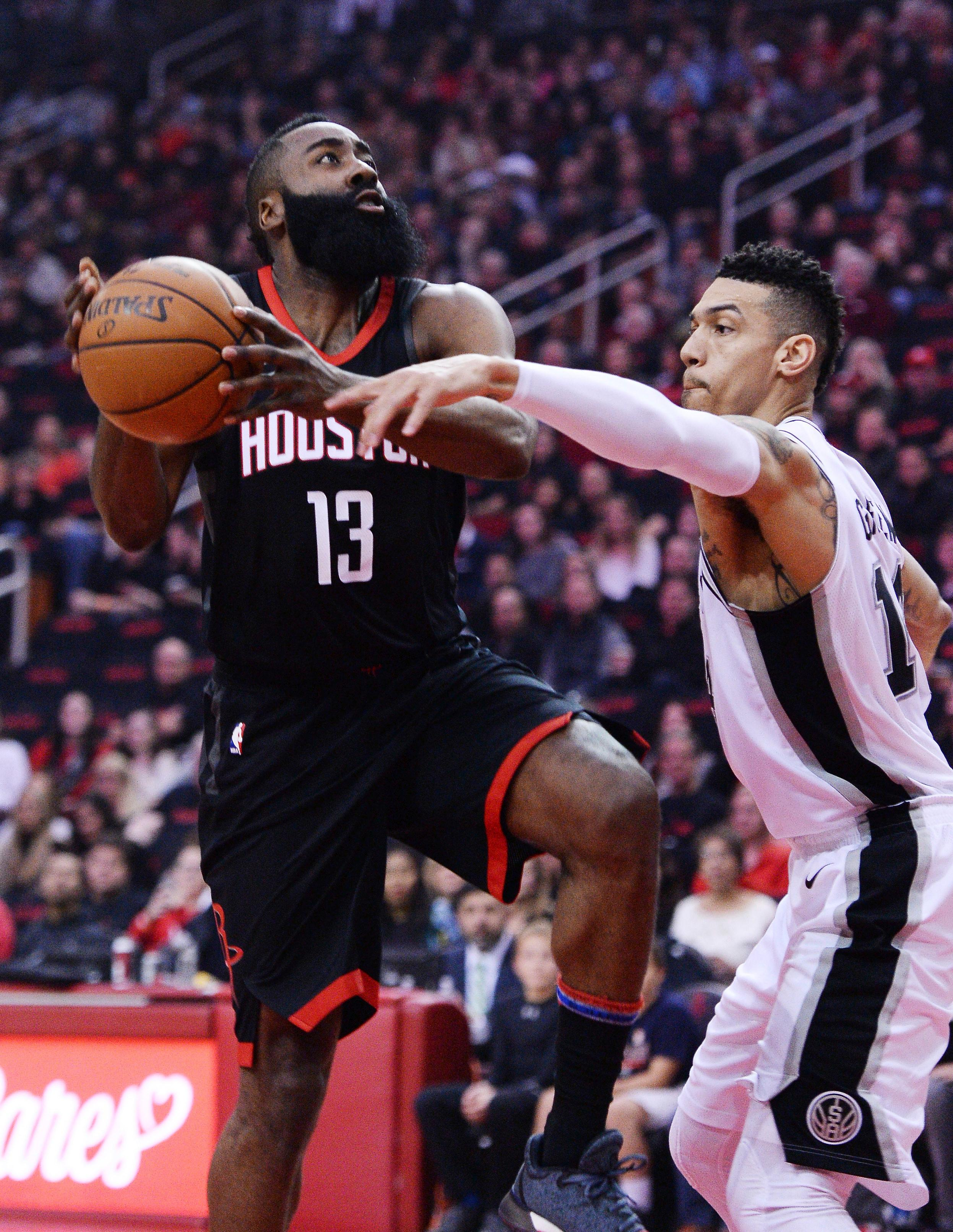 Houston Rockets guard James Harden (13) looks to shoot against San Antonio Spurs guard Danny Green (14) in the first half of an NBA basketball game Friday, Dec. 15, 2017, in Houston. (AP Photo/George Bridges)