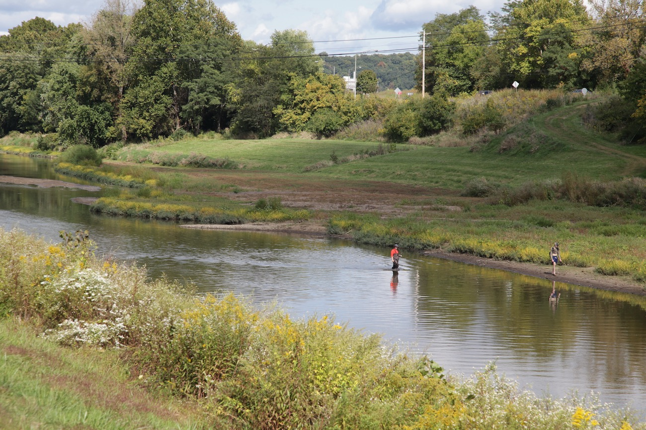 An angler tries his luck fly-fishing in the Hocking River along the Hockhocking Adena Bikeway. For 21 miles, the bikeway winds along the river, past the Ohio University campus, and through serene woodlands. / Image: Chez Chesak{ }// Published: 10.27.20