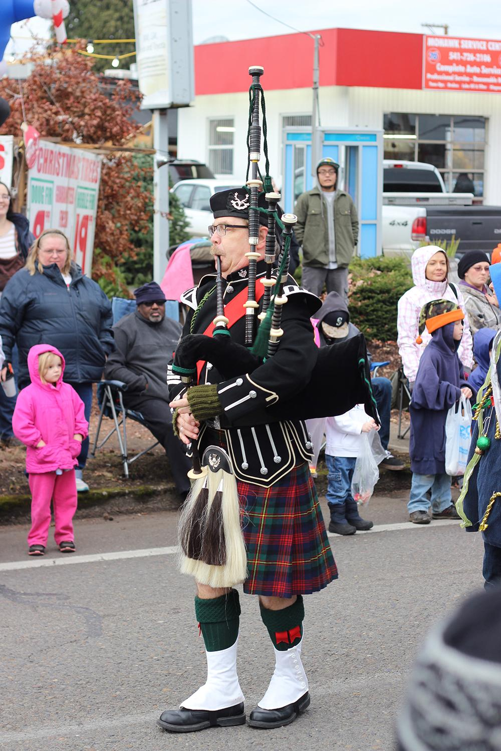 A bagpiper at the 63rd Annual Springfield Christmas Parade in Springfield, Ore., Saturday, Dec. 5. Photo by Claire Aubin.