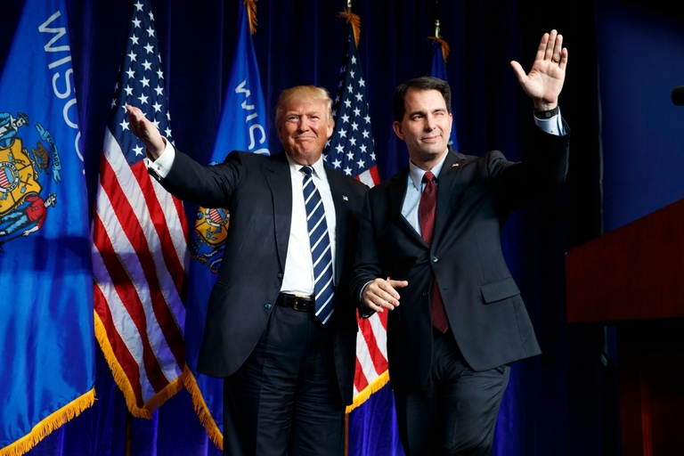 AP file photo of Pres. Donald Trump (L) and former Wisconsin Governor, Scott Walker.{ }
