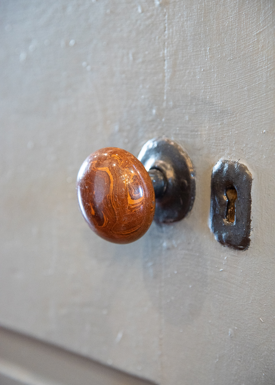 Tom polished many of the old door knobs to look like new. / Image: Phil Armstrong, Cincinnati Refined // Published: 3.15.19