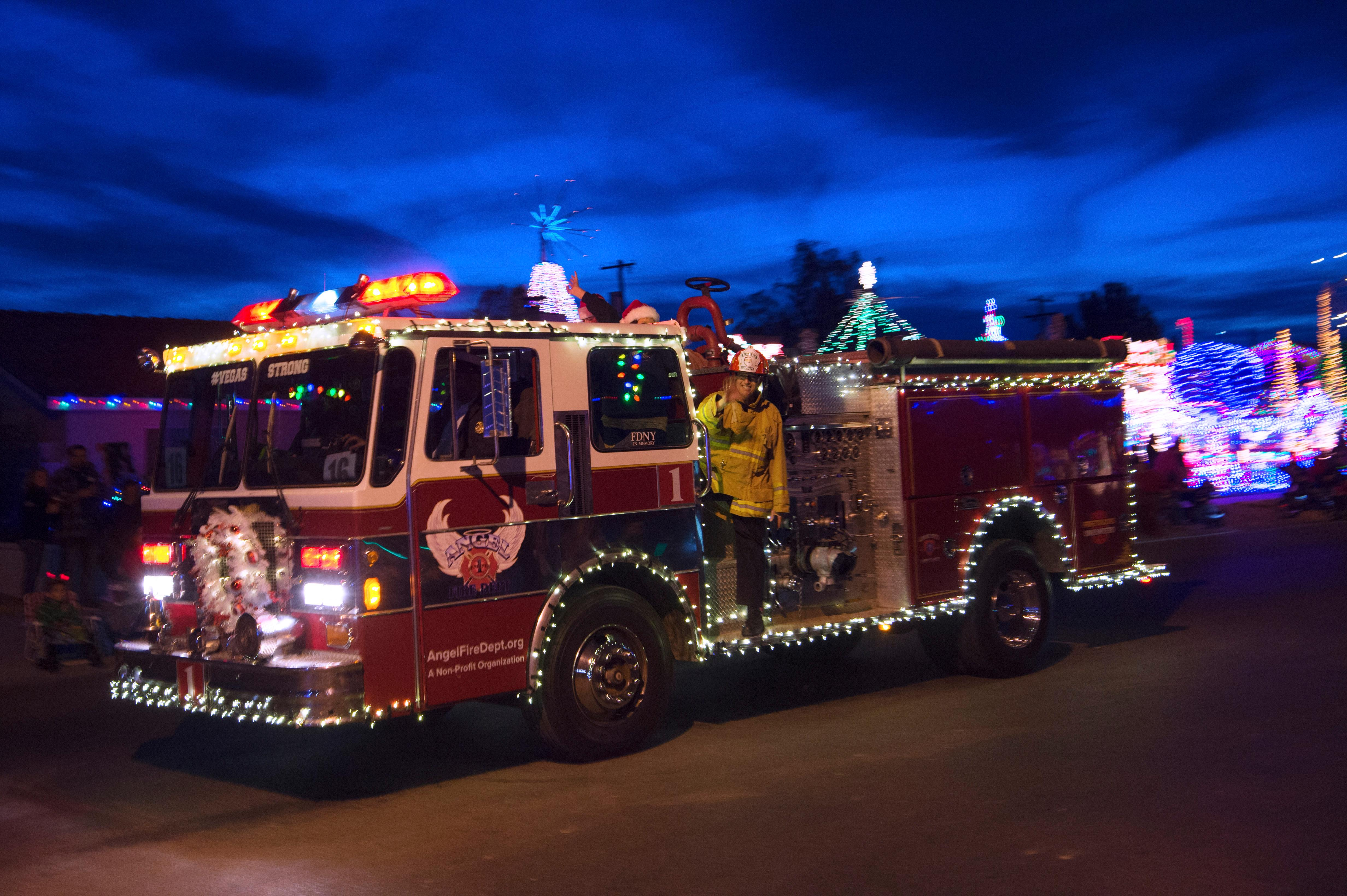 A decorated fire truck travels down 5th Street during the Santa's Electric Parade Saturday, December 2, 2017, in Boulder City. [Sam Morris/Las Vegas News Bureau]