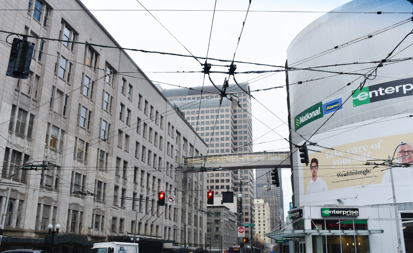 The most commonly known skybridge in Seattle might be the one that links the downtown Macy's building across Third Avenue to the parking garage. Installed in 1962, the skybridge has provided convenience and shelter from the weather for over 50 years. (Image: Rebecca Mongrain/Seattle Refined)