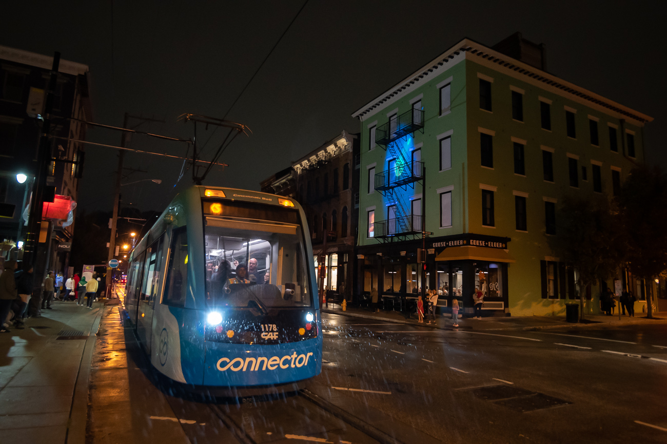 PICTURED NEIGHBORHOOD: Over-the-Rhine / By the end of Friday night, the wind had picked up, the temperature dropped, and the rain persisted. Many climbed aboard the free Cincinnati Bell Connector to escape the elements. / Image: Phil Armstrong // Published: 10.12.19